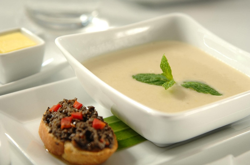 Cream of asparagus soup with olive chutney bruschetta.