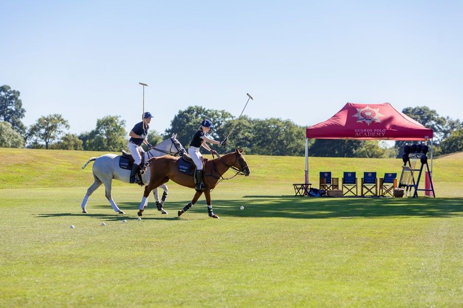 Coworth Park Guard Polo Academy lesson hitting balls in line - ALO Magazine
